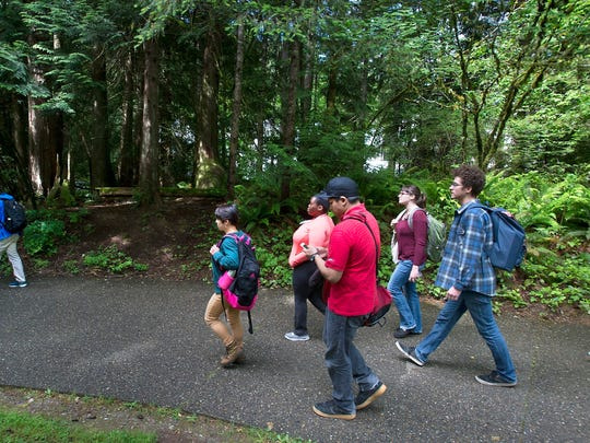 Students leave Evergreen State College campus in Olympia after a threat prompted a student alert and evacuation on Thursday.