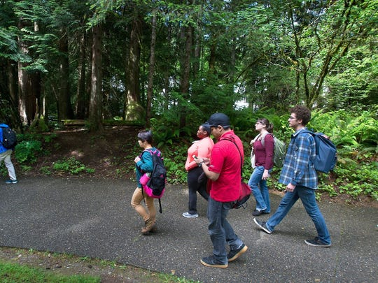 Students leave Evergreen State College campus after a threat prompted a student alert and evacuation. Students leave Evergreen State College campus in Olympia after a threat prompted a student alert and evacuation.