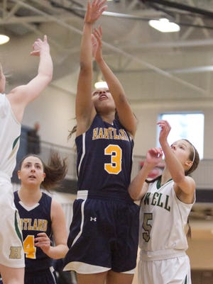 Hartland's Graysen Cockerham (3) scored the game's first eight points on 3-for-3 shooting before leaving a 46-24 district final victory over Howell with an eye injury.