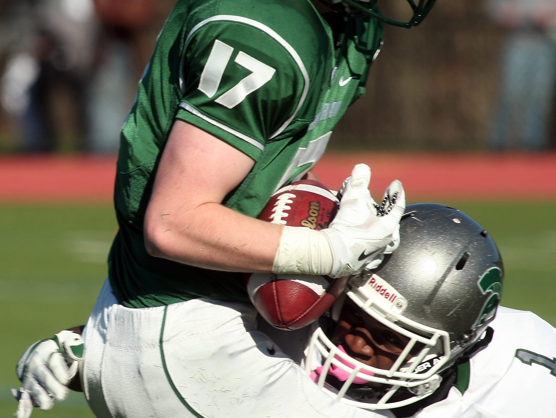 Delbarton's Kevin Hartley pulls in the ball after a fumble on a punt by DePaul's Nasir Hooker during the NJSIAA Non-Public Group III semifinal. November 21, 2015, Morristown, NJ.