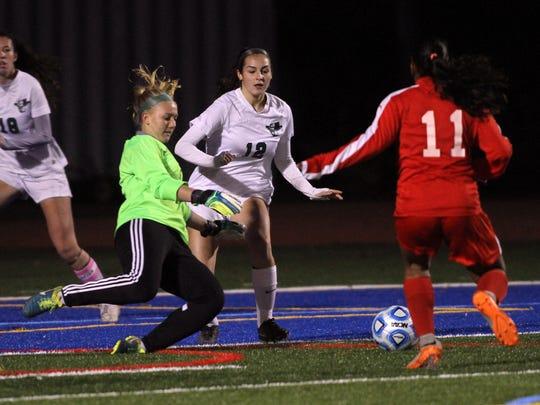 Kinnelon goalkeeper Emily Kapr challenges Glen Ridge's Halinka Prussak during their Group 1 semifinals girls soccer matchup at Millburn High School . November 17, 2015, Morristown, NJ.