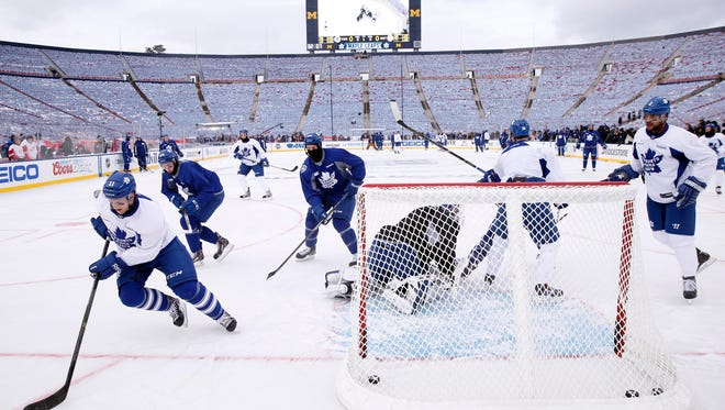 Toronto Maple Leafs players practice the day before the Winter Classic against the Detroit Red Wings at Michigan Stadium.