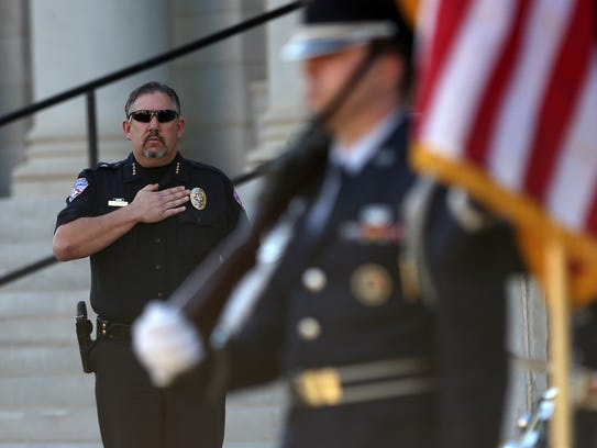 Police Chief Frank Carter stands during the Pledge
