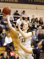 Notre Dame's Mary Foster puts up a shot in front of Watkins Glen's Emilia Bond last season at Notre Dame High School.