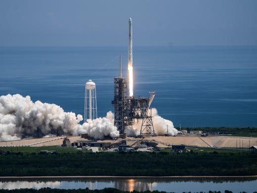 A SpaceX Falcon 9 rocket rocket takes off from the pad