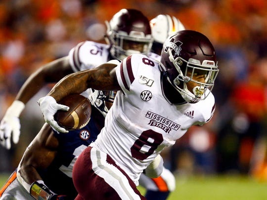 Mississippi State running back Kylin Hill (8) carries the ball during the first half of an NCAA college football game against Auburn, Saturday, Sept. 28, 2019, in Auburn, Ala. (AP Photo/Butch Dill)