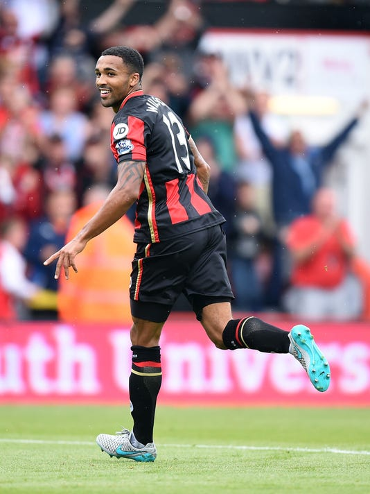 AFC Bournemouth's Callum Wilson celebrates scoring his side's first goal of the game during their English Premier League soccer match against Leicester City at the Vitality Stadium, Bournemouth, England, Saturday, Aug. 29, 2015. (Andrew Matthews/PA via AP)     UNITED KINGDOM OUT     -    NO SALES     -    NO ARCHIVES