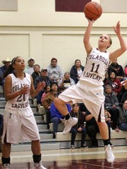 Shania Gililland, right, puts up a shot Tuesday night. Tularosa defeated Ruidoso 67-48.