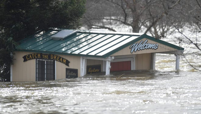 A building is partially submerged in flowing water at Riverbend Park as the Oroville Dam releases water down the spillway as an emergency measure in Oroville, Calif. on February 13, 2017.