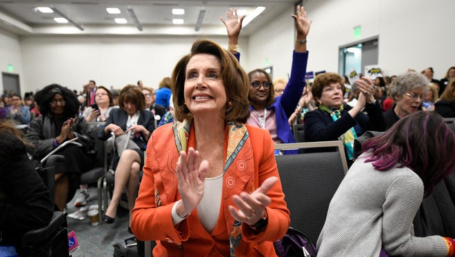 House Minority Leader Nancy Pelosi of Calif. applauds during the Women's Caucus at the 2018 California Democrats State Convention Saturday, Feb. 24, 2018, in San Diego. (AP Photo/Denis Poroy)