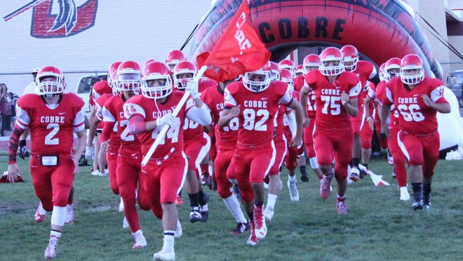 Cobre High runs out of the tunnel and will do it again Friday night when it hosts Silver in a rivalry District 3-4A meeting.