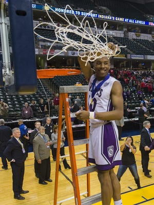 Ben Davis High School senior Datrion Harper (10) cuts down the game net after the team won the IHSAA 2017 Class 4A State Championship Game at Banker's Life Fieldhouse in Indianapolis, Saturday, March 25, 2017. Ben Davis won 55-52.