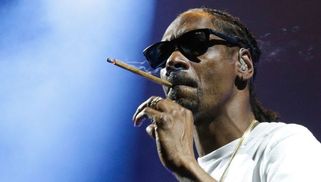 Snoop Dogg arrives onstage for Thursday's show at Klipsch Music Center.