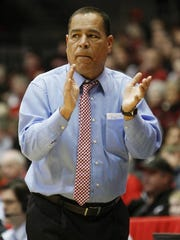 Houston head coach Kelvin Sampson reacts in the first half of an NCAA college basketball game against Cincinnati, Wednesday, Jan. 21, 2015, in Cincinnati. (AP Photo/Frank Victores)