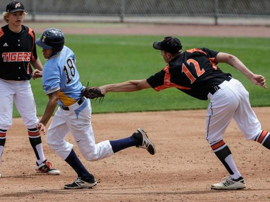 Webster High School baseball's Jack Washburn attempts