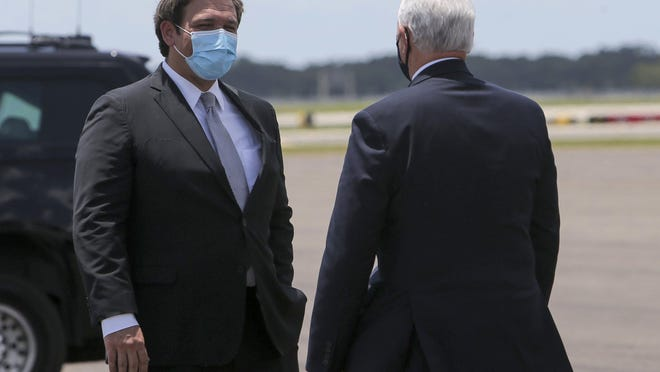 Florida Gov. Ron DeSantis greets Vice President Mike Pence upon his arrival at Tampa International Airport on Thursday, July 2, 2020, in Tampa. The Vice President met with Governor DeSantis regarding the efforts the state is making to combat COVID-19.