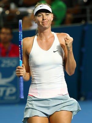 Maria Sharapova of Russia reacts after winning her match against Yaroslava Shvedova of Kazakhstan during the Brisbane International tennis tournament in Brisbane, Australia, Tuesday, Jan. 6, 2015. (AP Photo/Tertius Pickard)