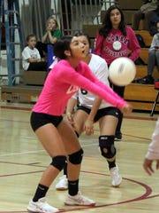 Marisa Ray digs this ball Thursday night against Cobre.