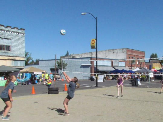 Playing some uptown beach volleyball in downtown Stayton: