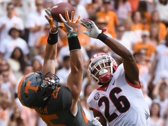 Tennessee wide receiver Josh Smith (25) and Georgia defensive back Tyrique McGhee (26) reach for a pass during the Tennessee Volunteers vs. Georgia Bulldogs game at Neyland Stadium in Knoxville, Tennessee on Saturday, September 30, 2017.