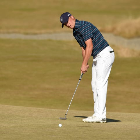 Jordan Spieth putts on the 14th green in the final