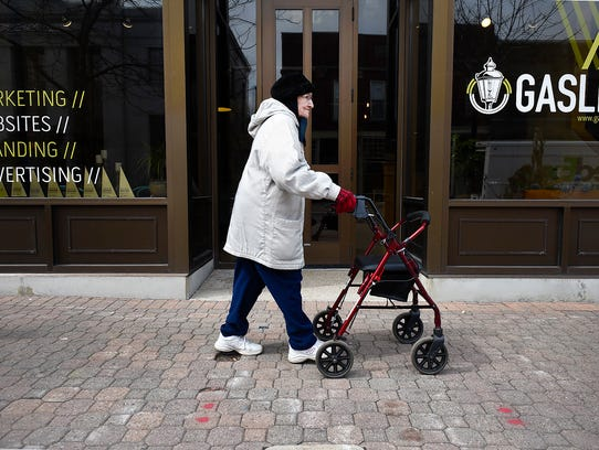 Irene Pundsack, 91, walks through downtown St. Cloud