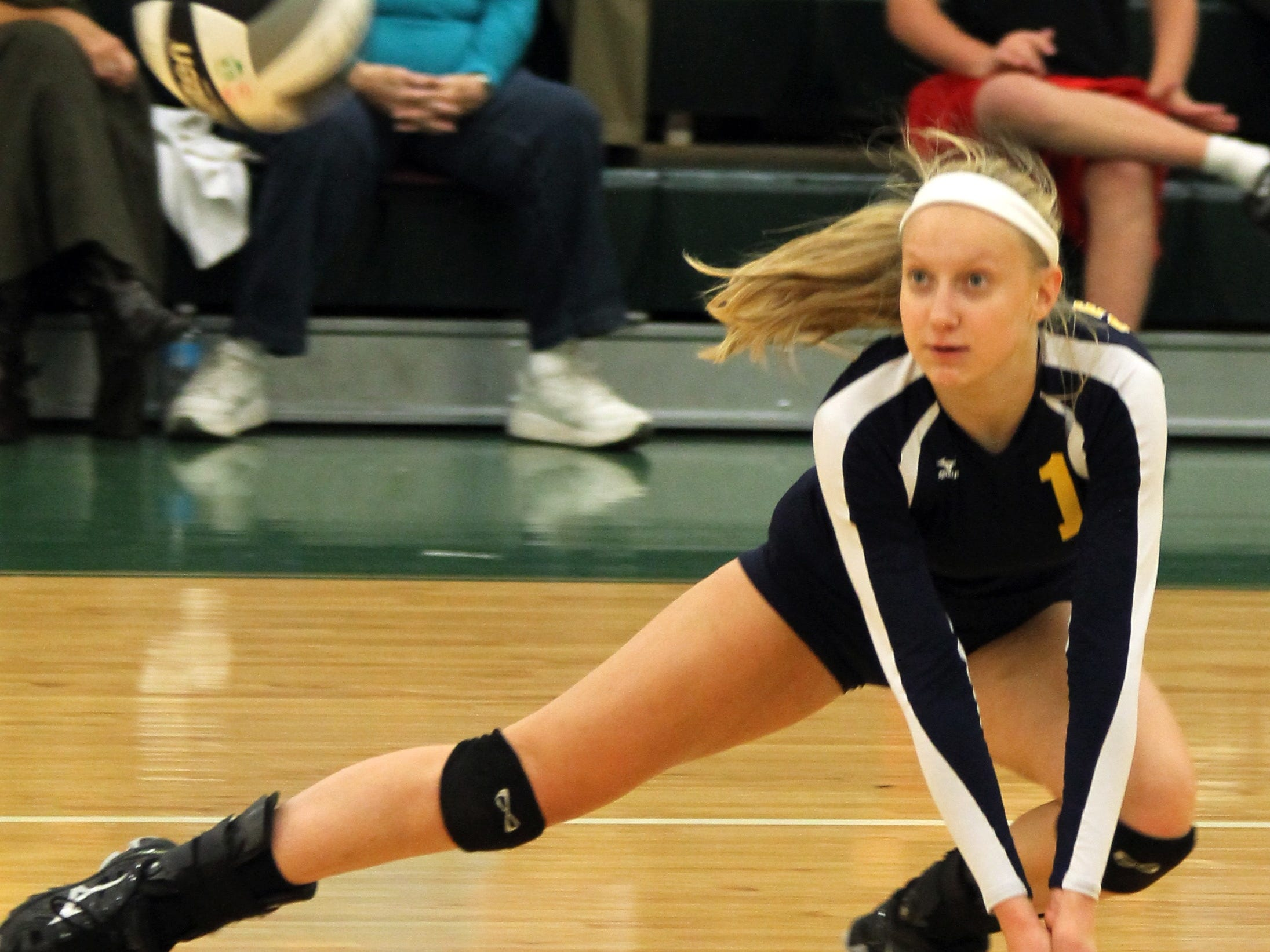 St. Ursula Academy's Anna Ficker (1) lunges to dig the ball against Ursuline Academy last season. She is one of three returning senior starters for the Bulldogs.