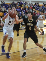 Wylie's Dylan Isenhower drives to the basket as Amarillo