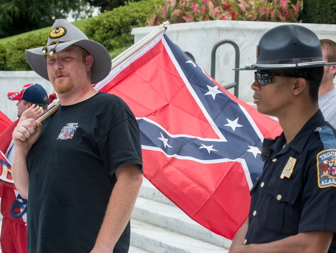 Jeremy Boothe of Tuscaloosa holds a Confederate battle