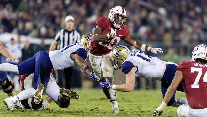 Nov 10, 2017; Stanford, CA, USA; Stanford Cardinal running back Bryce Love (20) runs the ball against the Washington Huskies  in the fourth quarter at Stanford Stadium. Mandatory Credit: John Hefti-USA TODAY Sports