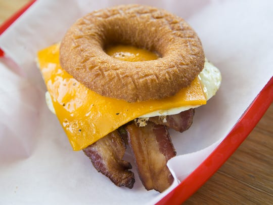 The S X SW breakfast sandwich is an egg, Cheddar and