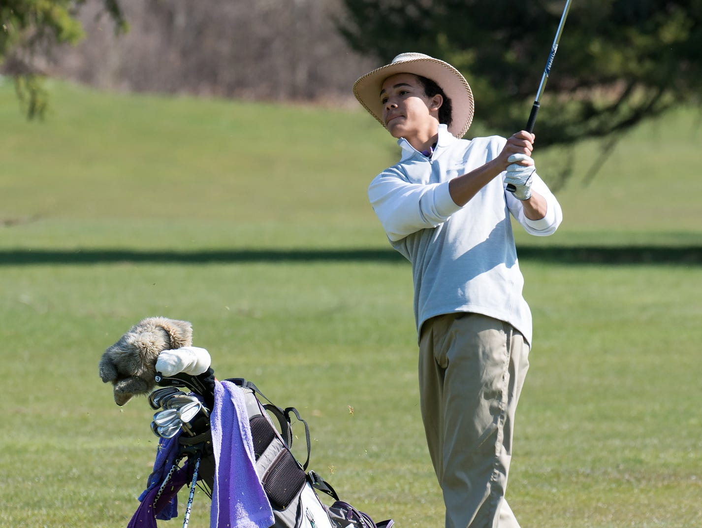 Lakeview's Andrew Walker chip-shots the green on the 12th hole Thursday afternoon at Cedar Creek golf course.