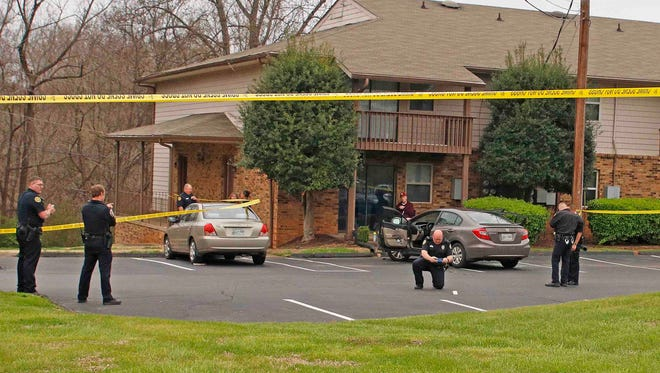 Clarksville Police respond to a shooting at an apartment complex on Memorial Drive on Sunday.