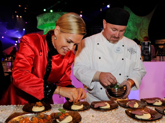 Iron Chef Cat Cora and sous chef Robby Sayles of Kouzzina by Cat Cora at DisneyÕs Boardwalk Inn plate Honey Lavendar Lamb Loin with smoked feta mash and kumquat pistachio chutney for guests attending a Party for the Senses grand tasting event during the Epcot International Food & Wine Festival at Walt Disney World Resort.  Party for the Senses events continue every Saturday through Nov. 3, 2012. (Todd Anderson, photographer)
