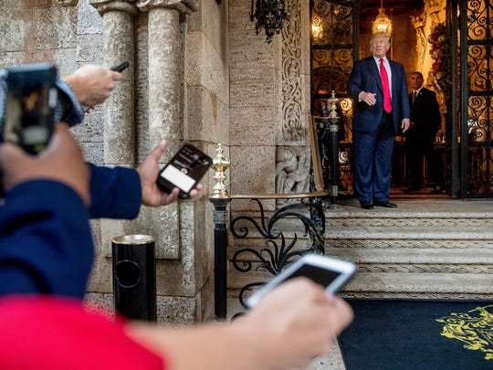 President-elect Donald Trump, right, speaks to members of the media after a meeting with admirals and generals from the Pentagon at Mar-a-Lago, in Palm Beach, Fla., Wednesday, Dec. 21, 2016.