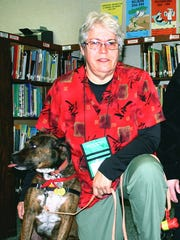 Cathy Guse and her therapy dog Kota.  Cathy volunteers to bring her therapy dog to Port Edwards Elementary School.