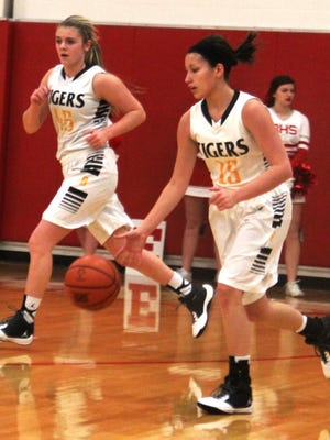 Bellevue junior Courtney Schmits, 15, starts the offense with senior Kira Ross nearby.