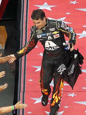 Jeff Gordon greets fans during driver introductions