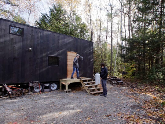 Hilary Lentz and her husband Shane leave the tiny house which they rented for a weekend in Croydon, N.H.