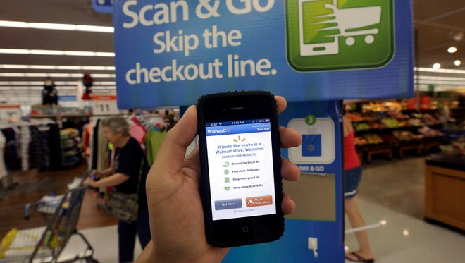 Scan & Go  smartphone app at a Wal-Mart store in San Jose, Calif. , Sept 19, 2013.