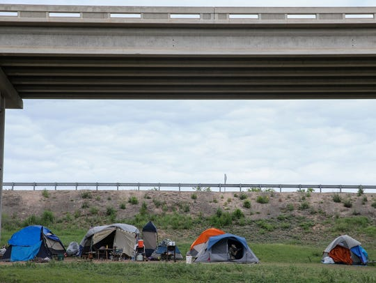 """Homeless people have been living in a """"tent city"""" under"""