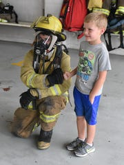 A visitor to the Mountain Home Fire Department bumps