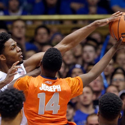 Duke's Justise Winslow blocks a shot by Syracuse's Kaleb Joseph during the first half in Durham, N.C., on Saturday. Winslow scored a season-high 23 points to lead the Blue Devils to victory.