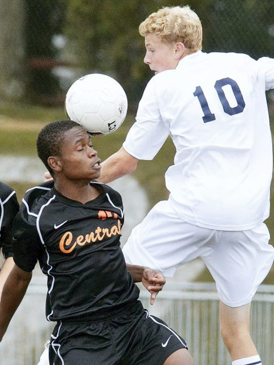 Central York's Pierce Miller, left, and Dallastown's Kyle Schimmel battle for possession during a boys' soccer match in 2014. The Panthers and the Wildcats battled in the York-Adams League title game last year, with Central prevailing, 1-0. Both teams figure to be strong again this season.