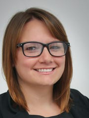 Caitlin Newby has been promoted to programs and events