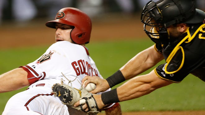 The Diamondbacks' Paul Goldschmidt (44) slides safely home before a tag from the Pirates' Francisco Cervelli (29) at Chase Field on April 24, 2015.