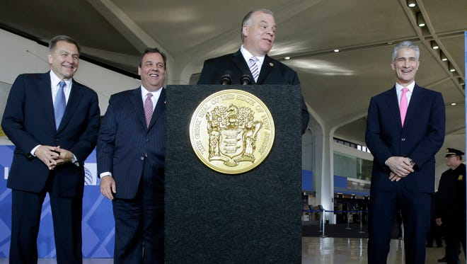 In this Thursday, Nov. 14, 2013 file photo, New Jersey Gov. Chris Christie, second left, New York/New Jersey Port Authority Chairman David Samson, left, and and United Airlines CEO Jeff Smisek, right, laugh as New Jersey Senate President Steve Sweeney, addresses a gathering at Newark Liberty International Airport, in Newark, N.J. David Samson, the former chairman of the agency that controls New York City-area bridges, tunnels and airports arrived at a New Jersey courthouse Thursday, July 14, 2016, ahead of a planned court appearance and a news conference by federal investigators. The U.S. attorney's office in New Jersey has been investigating whether Samson, a political mentor to Republican Gov. Chris Christie, wrongfully used his Port Authority of New York and New Jersey post to get United Airlines to provide direct air service to South Carolina in 2014 to make it easier to get to his vacation home.