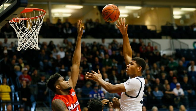 Monmouth Hawks forward Diago Quinn (32) shoots over Marist Red Foxes center Kentrall Brooks (1) during first half at Ocean First Bank Center, Monmouth University. West Long Branch,NJ. Sunday, January 8, 2017.