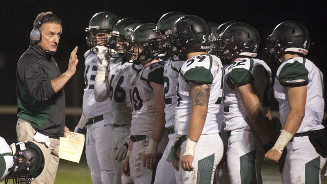 Clyde Folsom instructs his West Deptford football team in a timeout during the Eagles' win over Collingswood in Nov. 2016. Folsom stepped down as coach Friday.