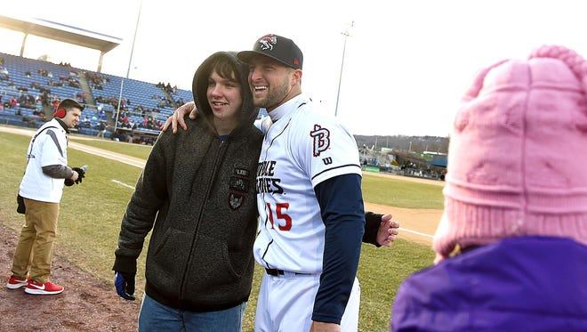 Tim Tebow poses with a fan before the Binghamton Rumble Ponies played the Portland Sea Dogs in the opening game of the 2018 season at NYSEG Stadium. Tebow hit seventh and played left field.